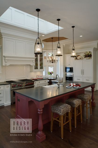 Lanterns Hanging Over A Slightly Rustic Island In This Traditional Kitchen Lighting Fixtures
