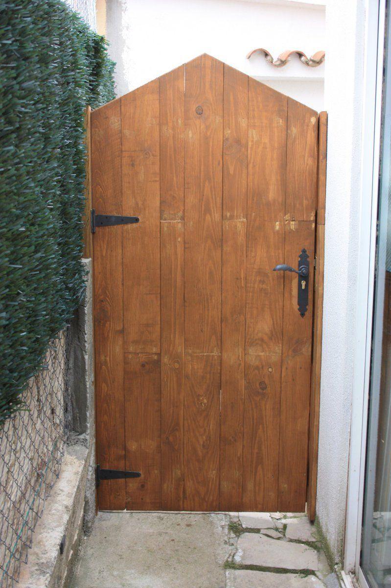 Puerta rustica a partir de madera de palet pallets porton rustico puertas y madera - Puerta madera rustica ...