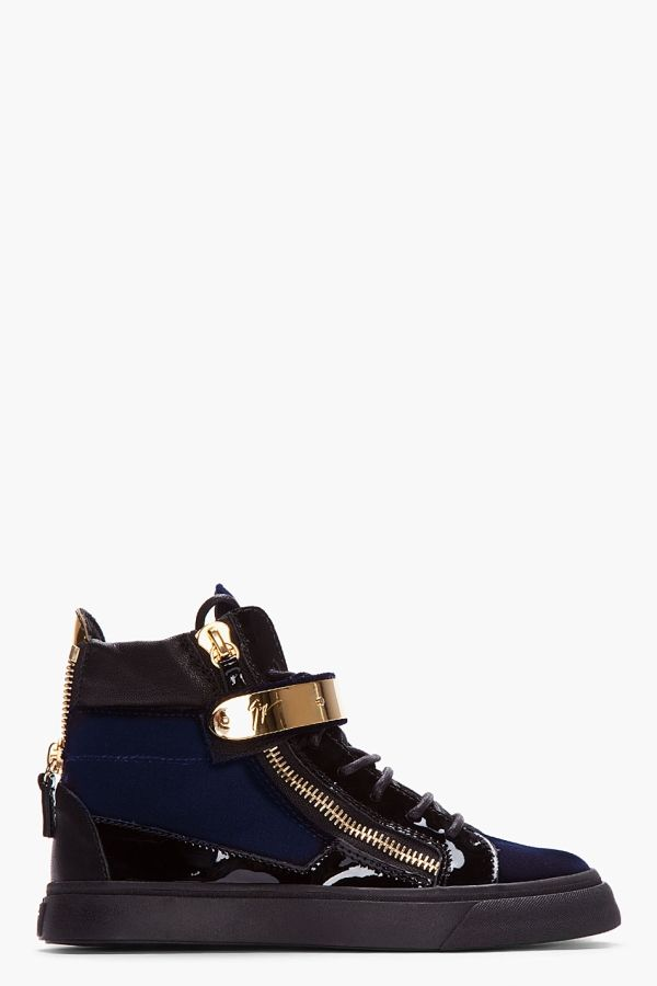 igh top velvet sneakers in navy. Round toe. Gold tone hardware. Black lace up closure with black patent leather eyerow. Leather logo patch at tongue. Foldover velcro strap at shoe face with metal bar embellishments. Signature zip closures at eyerow and heel collar. Leather pull tab in metallic gold. Contrast matte leather and patent leather paneling throughout. Black rubber foxing. Tone on tone stitching. $775.00 by ssense