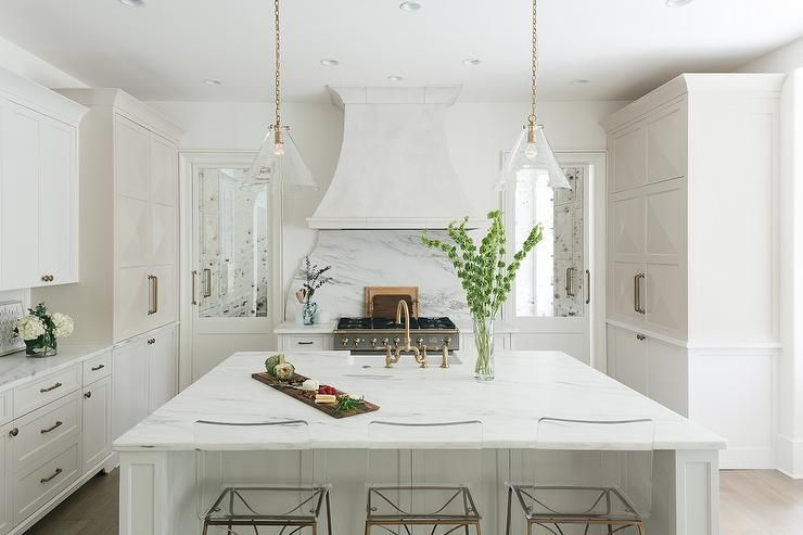 Mirrored Pantry Doors Flank A White Wood Panel French Vent