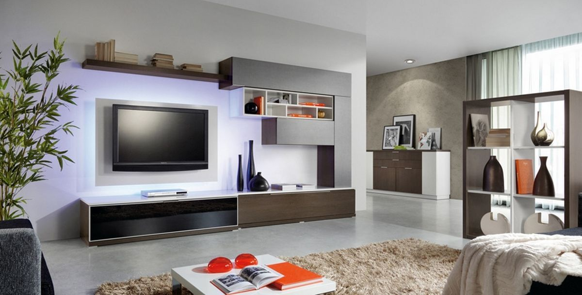 Unique wall shelves create a tidy niche for the television ...