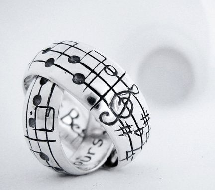 "Love this! Get ""your song"" engraved on your wedding bands"