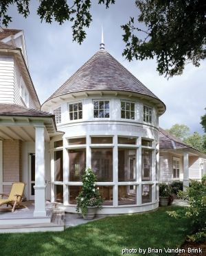 A Rounded Porch With Conical Roof And Clerestory Windows