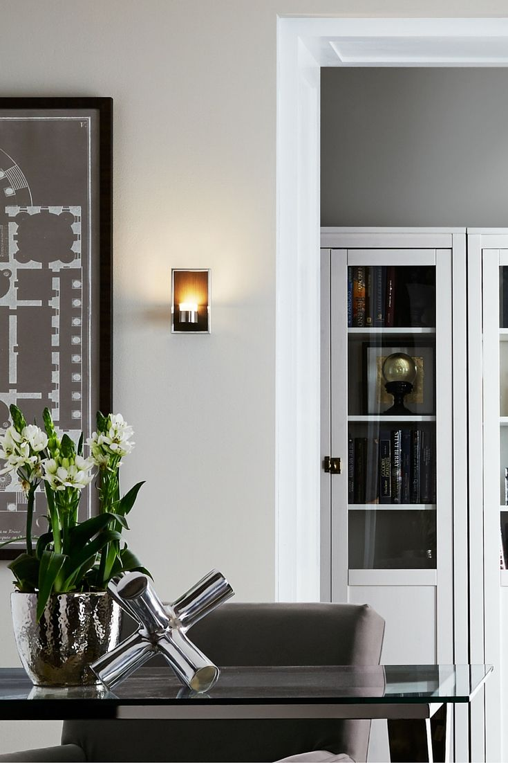 The sleek metal backplate of the dobson wall sconce light from tech
