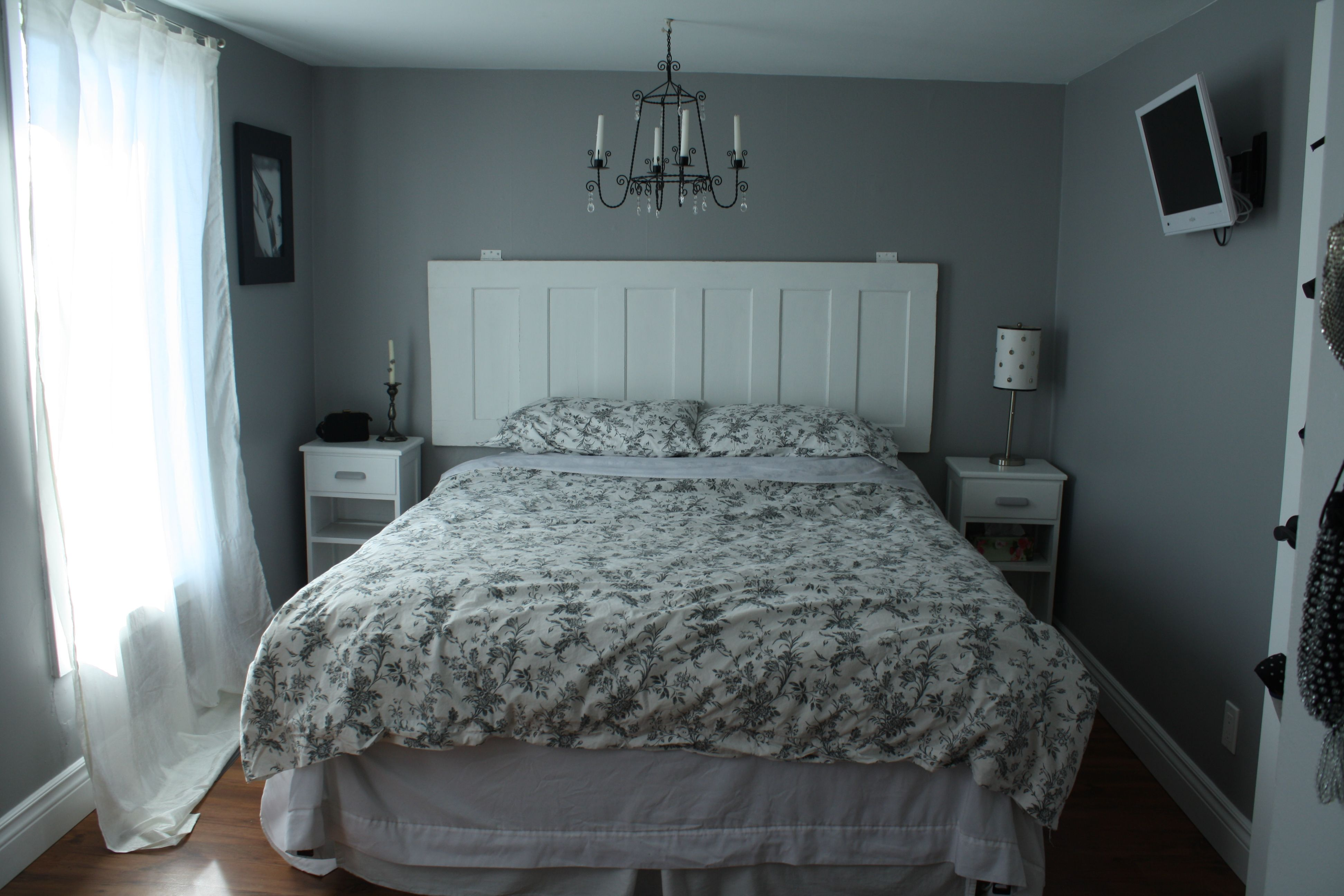 I really love the idea of using an old door for a headboard but i