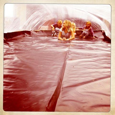 Giant plastic bubble play. seems like a fun photo op too!
