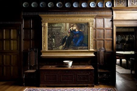 LOVE AMONG THE RUINS by Burne-Jones, 1894, against the oak panelling of the Great Parlour at Wightwick Manor