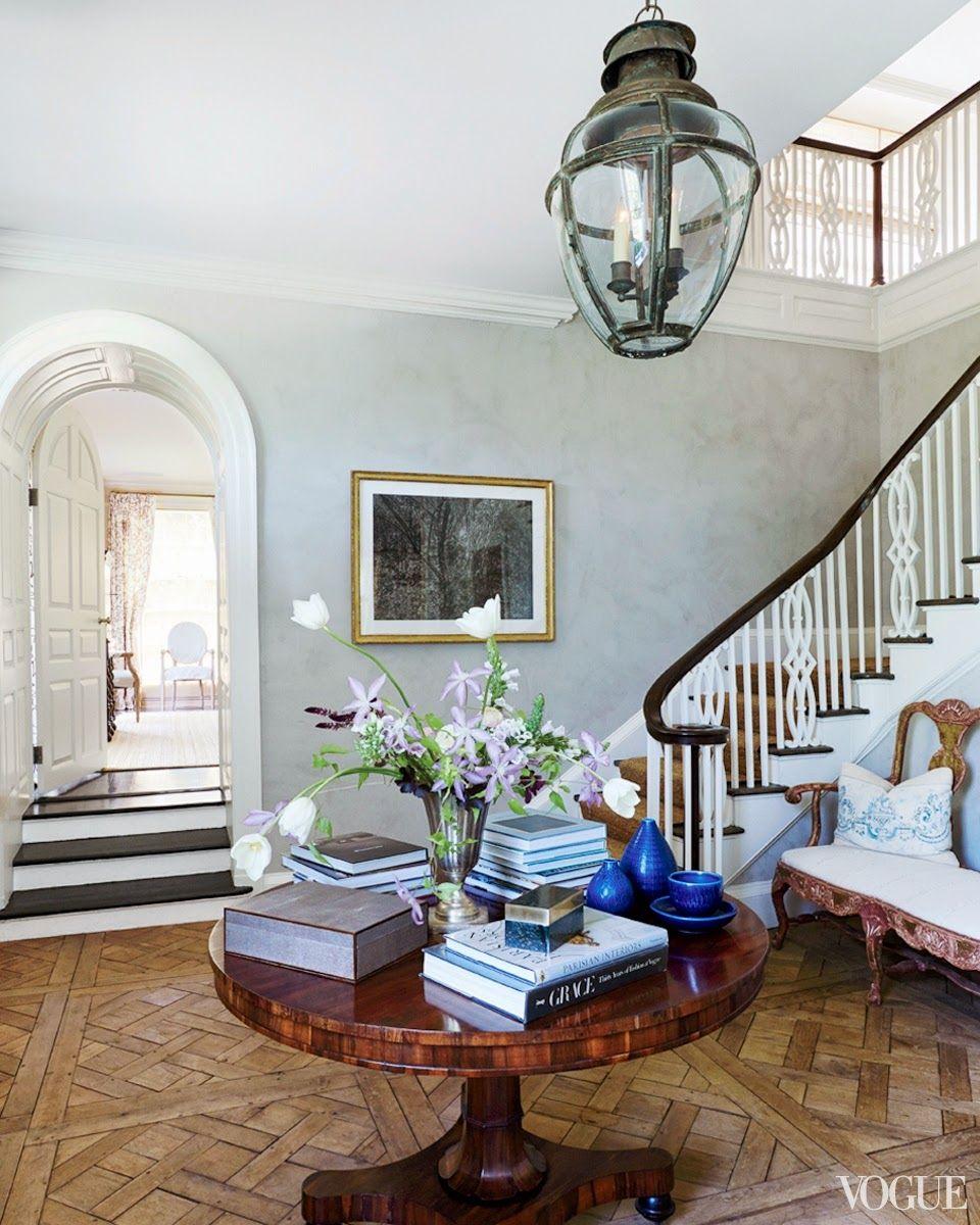 Vogue Emilia Fanjul Pfeifler home- Oversized lantern, staircase, millwork around arch doorway, parquet floor- use each detail separately!
