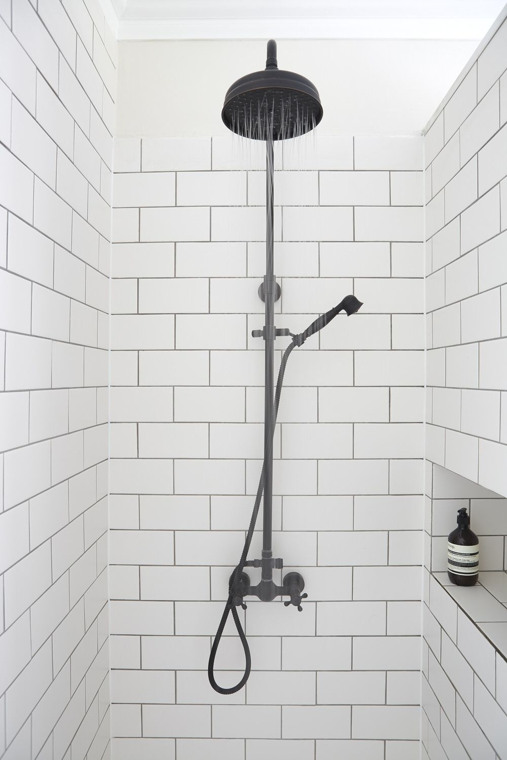 Foxgrove house marketed by mr mrs clarke see more of this love white subway tile with gray grout plus black shower fitting dailygadgetfo Images
