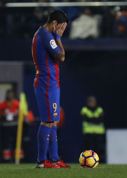 Barcelona's Uruguayan forward Luis Suarez reacts to a goal of Villarreal  during the Spanish league football
