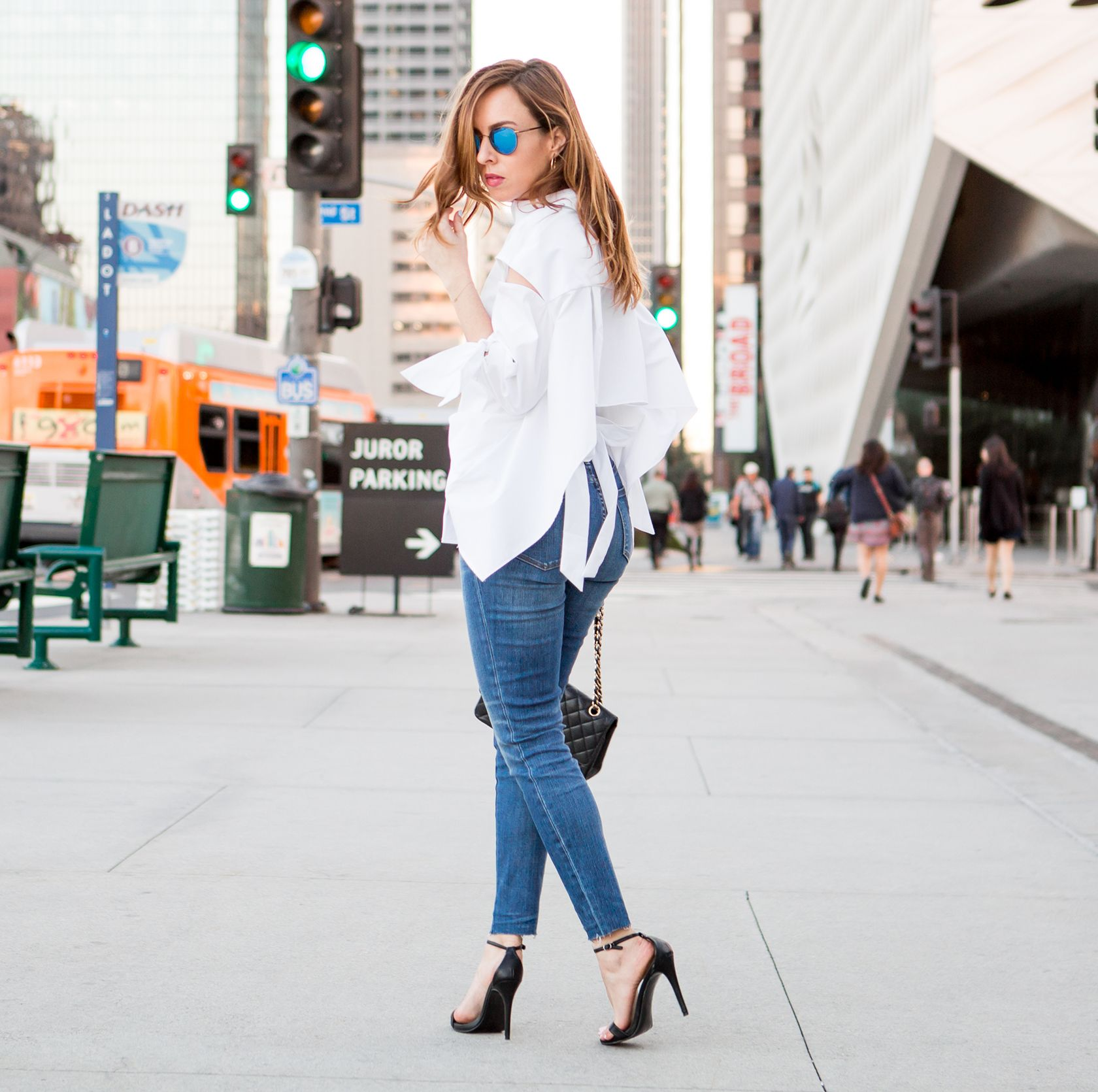 f72109d17f40 Sydne Style wears Milly white button down shirt with skinny jeans for spring  outfit ideas
