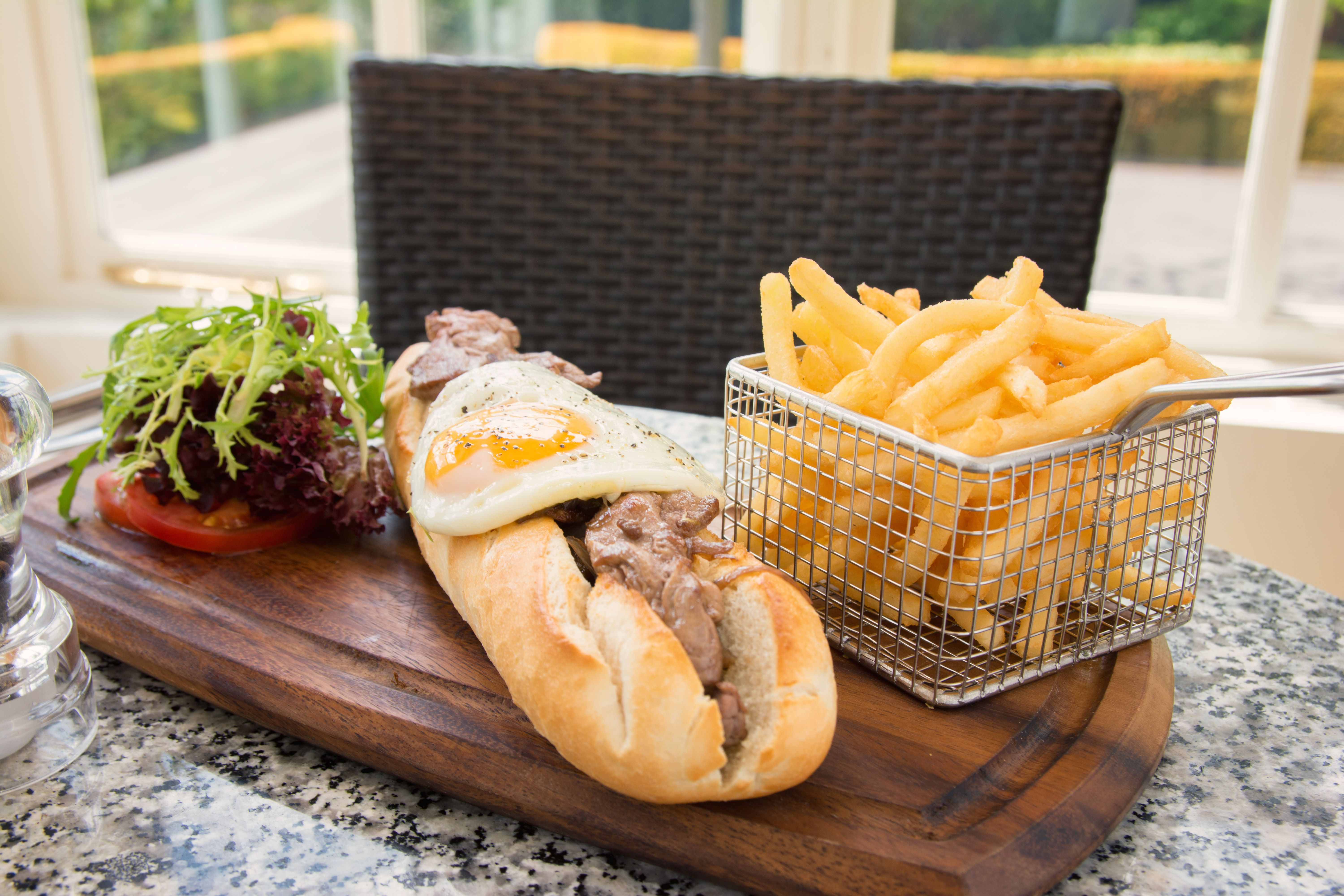 Bookmakers' Baguette - Seared Fillet of Beef with Caramelised Red Onion  Served with Fries and a Free Range Fried Egg  lunch idea. lunch time treat. Bar food. Bar meal.