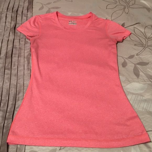 Under Armour fitted workout shirt Women's small fitted heat gear workout short. Worn and loved but great condition. No stains or rips. Smoke free home. Under Armour Tops Tees - Short Sleeve