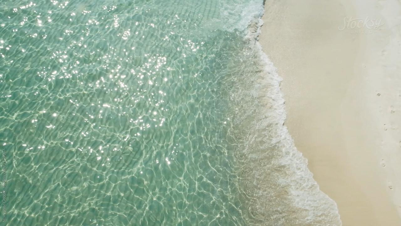 Sun Sparkling on Tropical Ocean Water