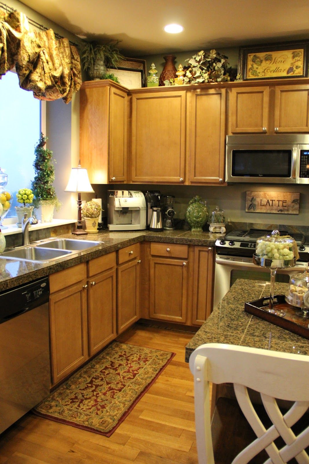 Above cabinets decor | Classy kitchen, Decorating above ...