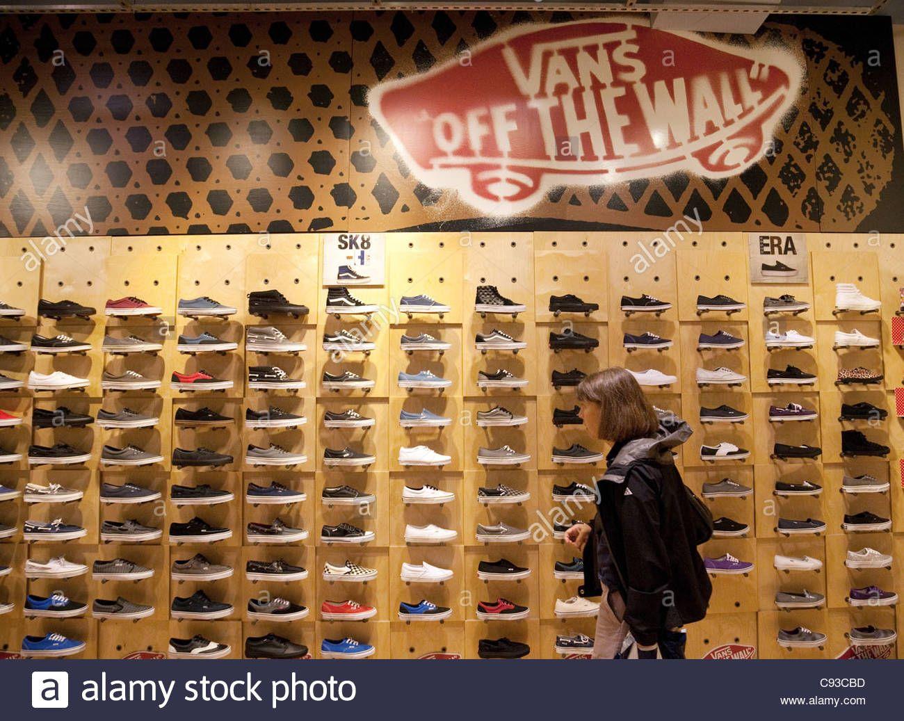 woman buying Vans shoes in a Vans Shoe