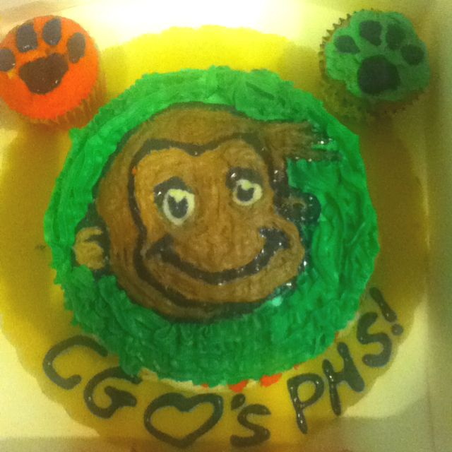 Curious? It's a cake I made for my math class, if you cut it open the insides are green and orange, our school pride