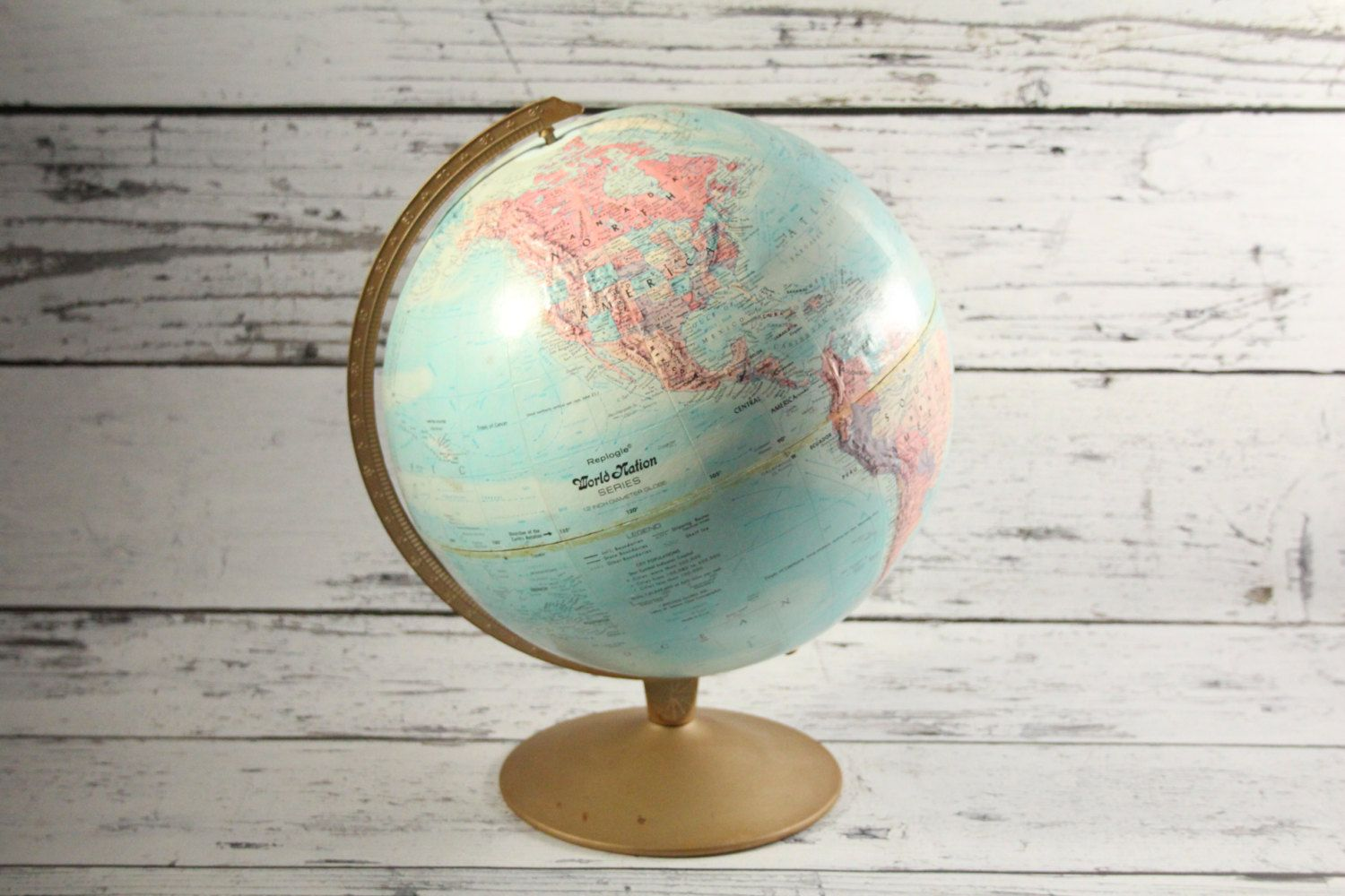 Vintage replogle globe world nation light blue antique colored brass globe world nation light blue antique colored brass metal base earth spinning 12 inch diameter world map topographical by brooklynbornfinds on etsy gumiabroncs Image collections