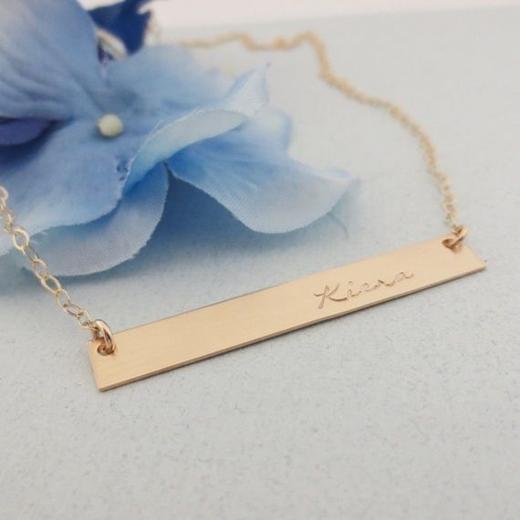 (http://www.stampedunderthemoon.com/gold-personalized-bar-necklace/)