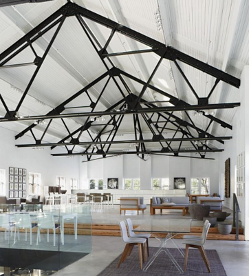 Avenue road showroom black trusses contrast with white for Exposed roof truss design