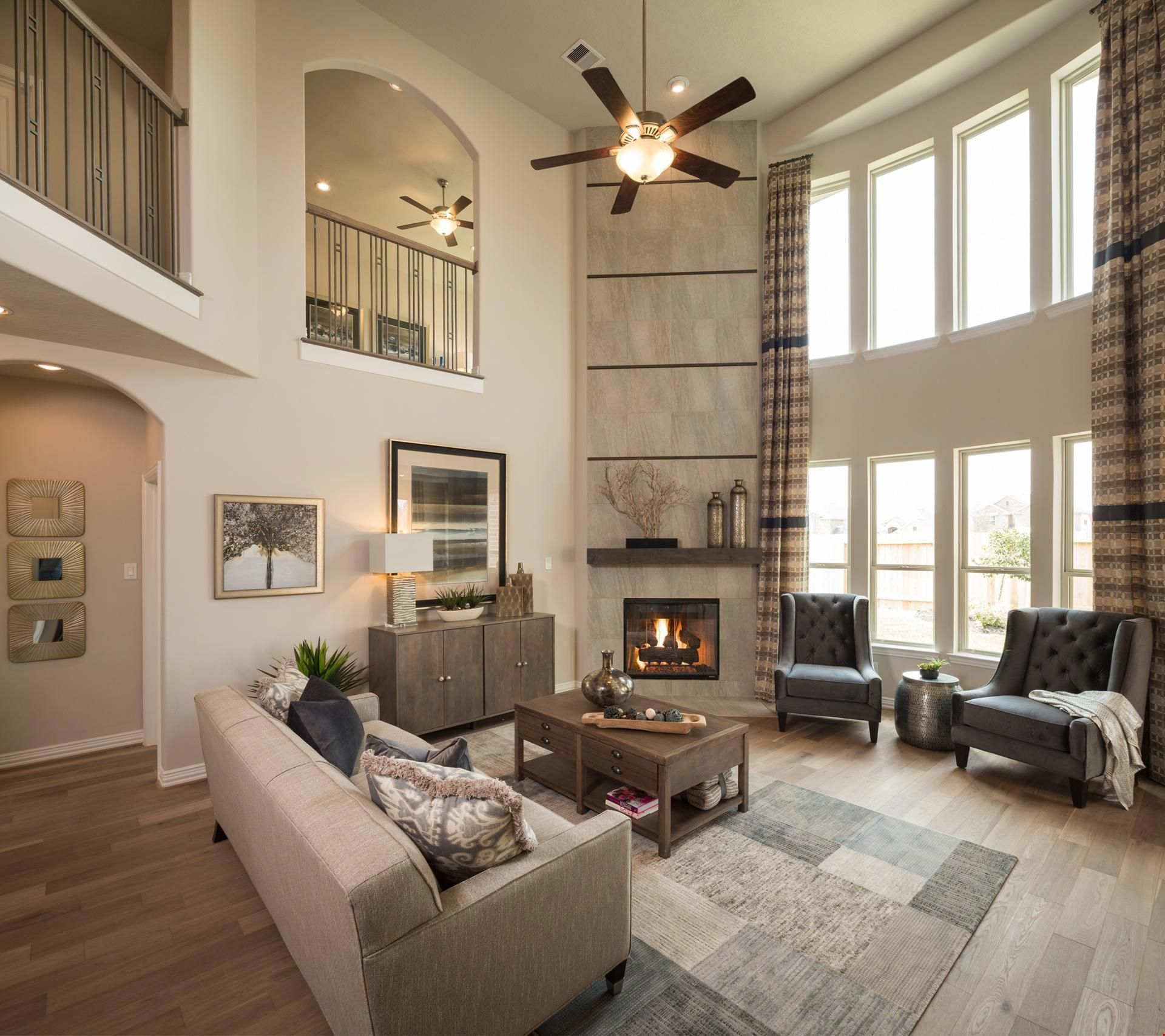 A soaring, two-story great room makes a dramatic design ...