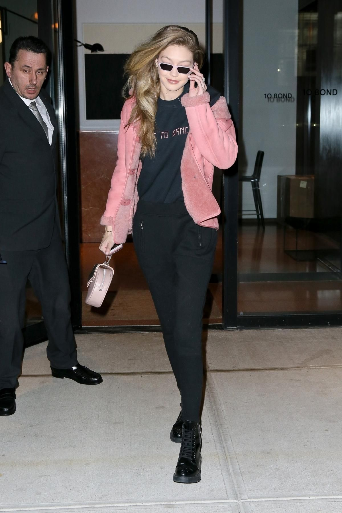 2d83bd1d2d9a Gigi Hadid wearing Okhtein Nude Mini Dome Bag, Paradised Dance Embroidered  Sweatshirt, Illesteva Baxter Sunglasses in Pale Pink and Casetify Custom  Name ...