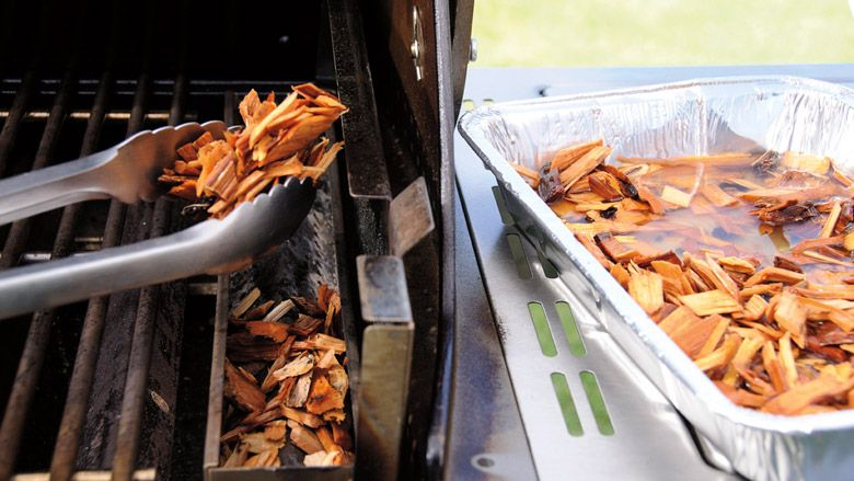 Make your own smoking tray for your gas grill.