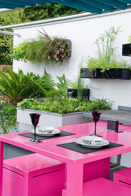 Modern Patio Design With Hot Pink Outdoor Furniture