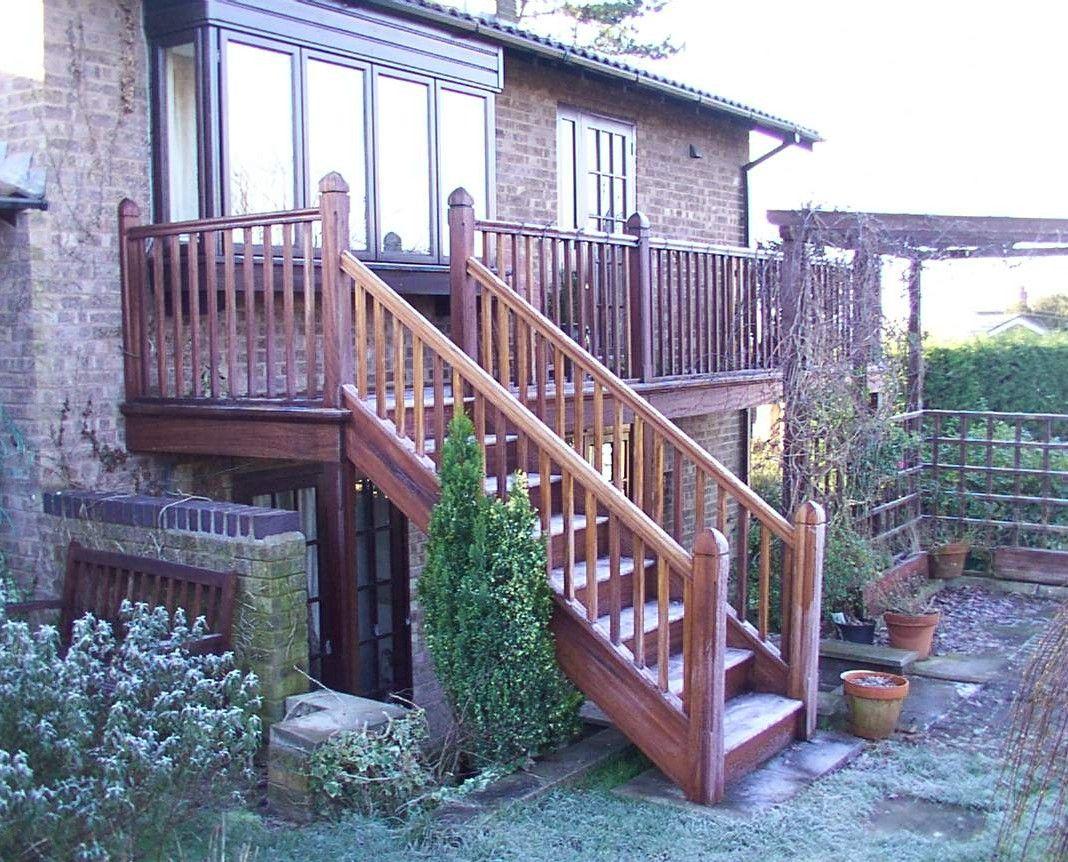 External iroko staircase wtih balconcy giving access to garden by Merrin  Joinery