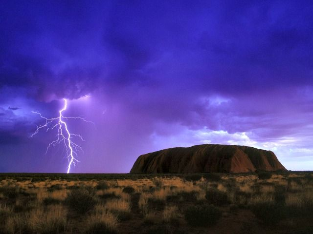Lightening in the distance near Ayers Rock ~ http://suitcasesandsunsets.com/ayers-rock.html