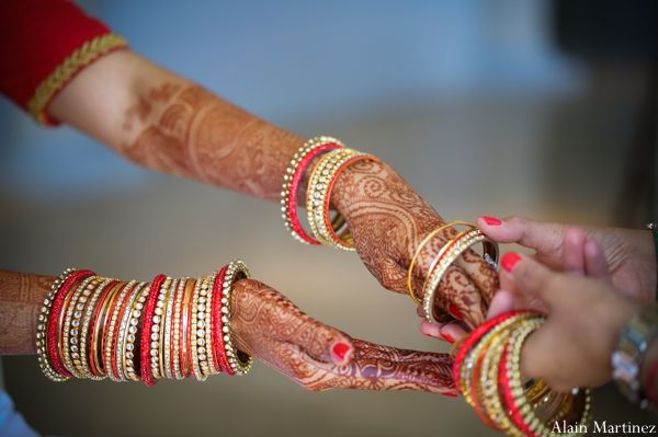 A Bridal Portrait Of The Bride Before Her Ceremony In Hair And Makeup Details Henna Bangles