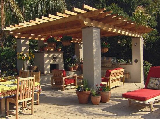 If patio space is an issue, a detached pergola with fireplace sitting out in the yard works great.