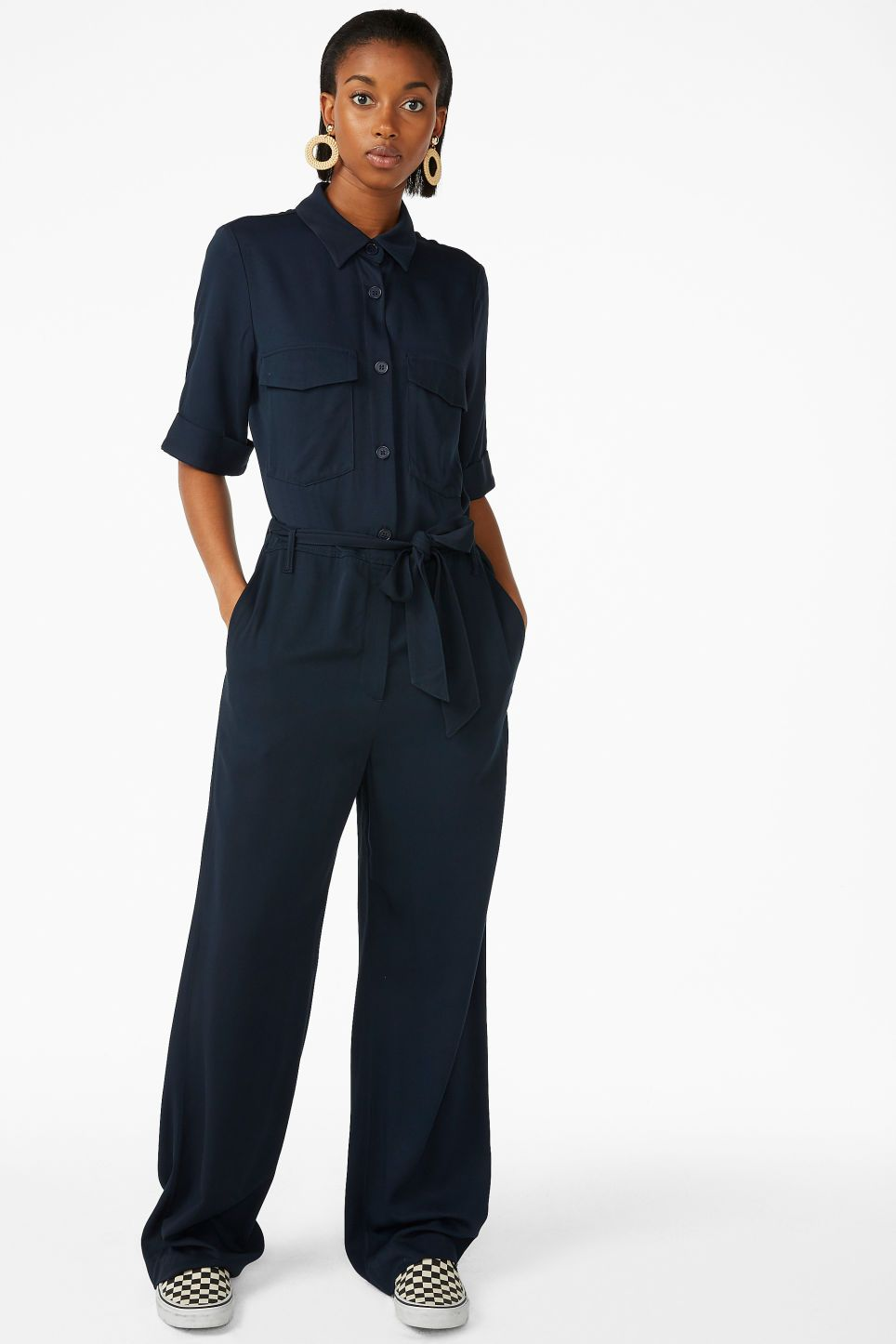 34167ef6a7 Monki tie-waist jumpsuit in blue - A belted utility jumpsuit in a midnight  blue shade with rolled up-style sleeves
