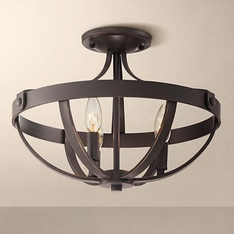 A rich bronze finish semi flushmount ceiling light with exposed lights in the center for