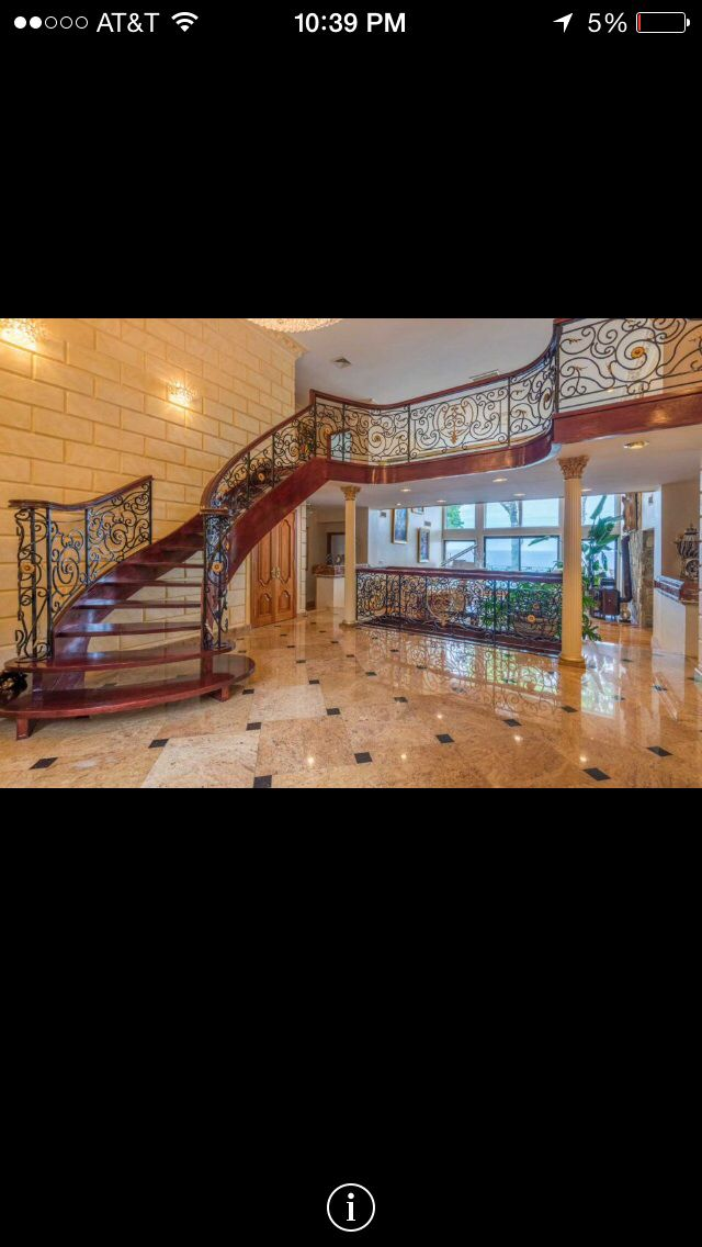 Custom staircase with tile work and faux painted stone on walls