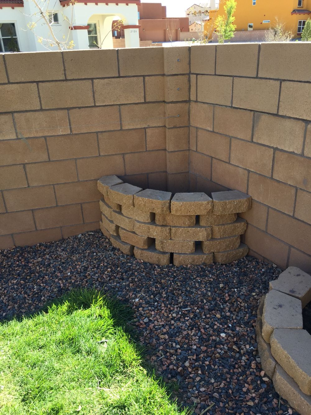 this is a compost bin made from landscaping bricks i left spaces