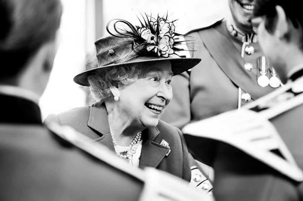hm the queen having a chat with those assembled hm the queen our