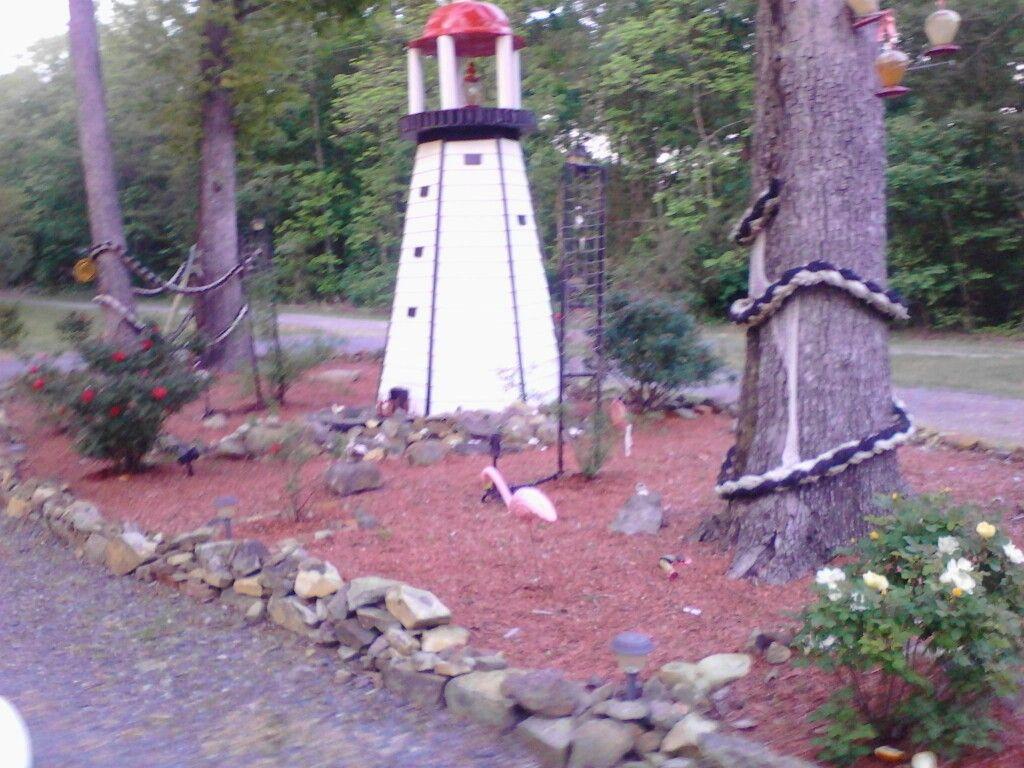 Yard lighthouse Yard lighthouse, Garden arch, Outdoor