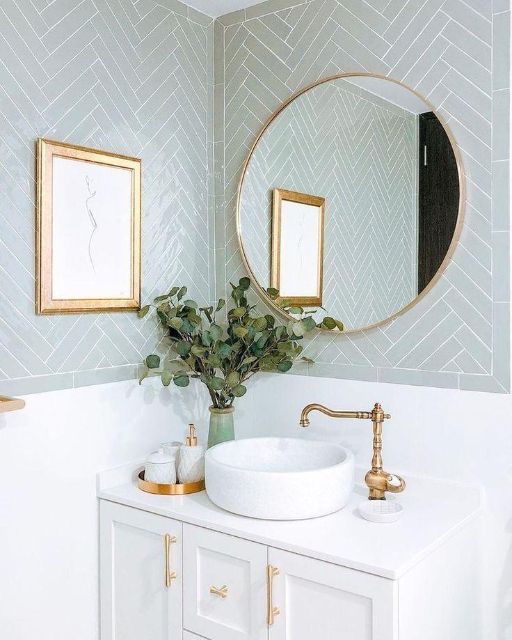 Round mirror in minimalist white bathroom decor ideas