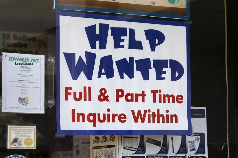 © Reuters. An advertisement for job openings is seen outside a store  in Port Washington, New York
