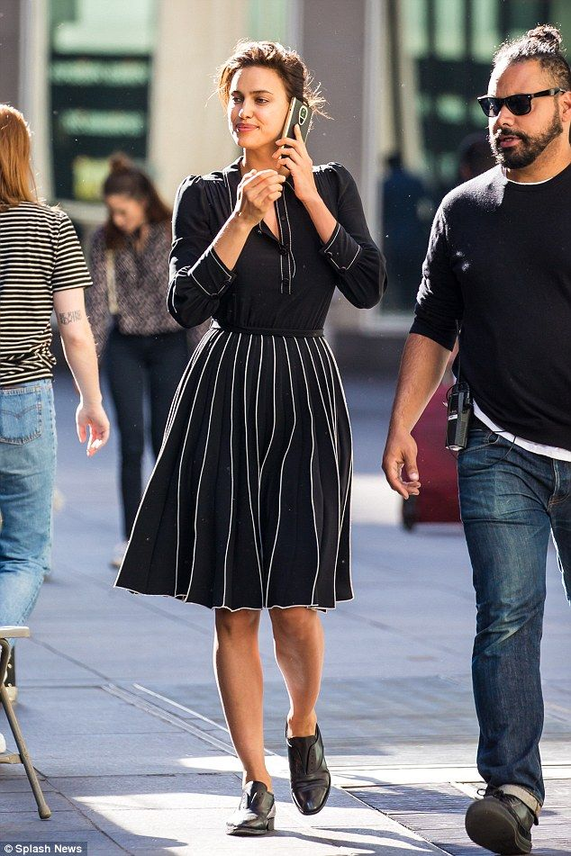 db69215247 Irina Shayk paused to take a phone call from someone who may have been her  beau Bradley Cooper during a photo shoot in NYC on Friday with famed  photographer ...