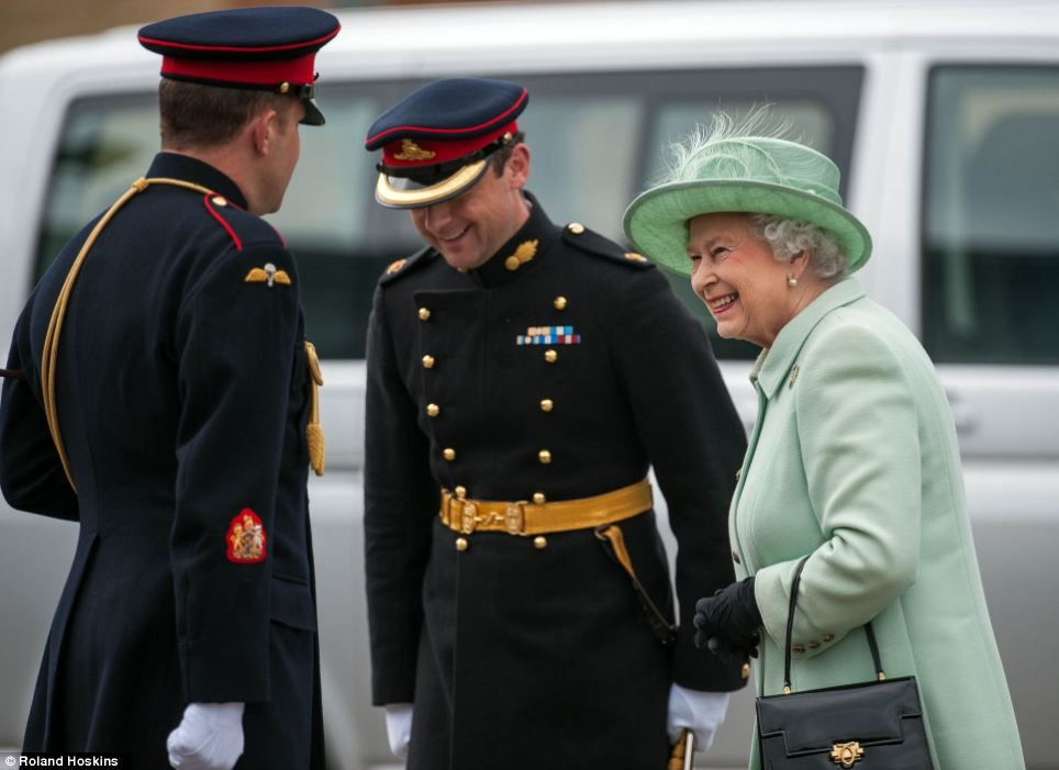 The Queen viewed some of the horses before watching a gun team display in the riding school and meeting more soldiers