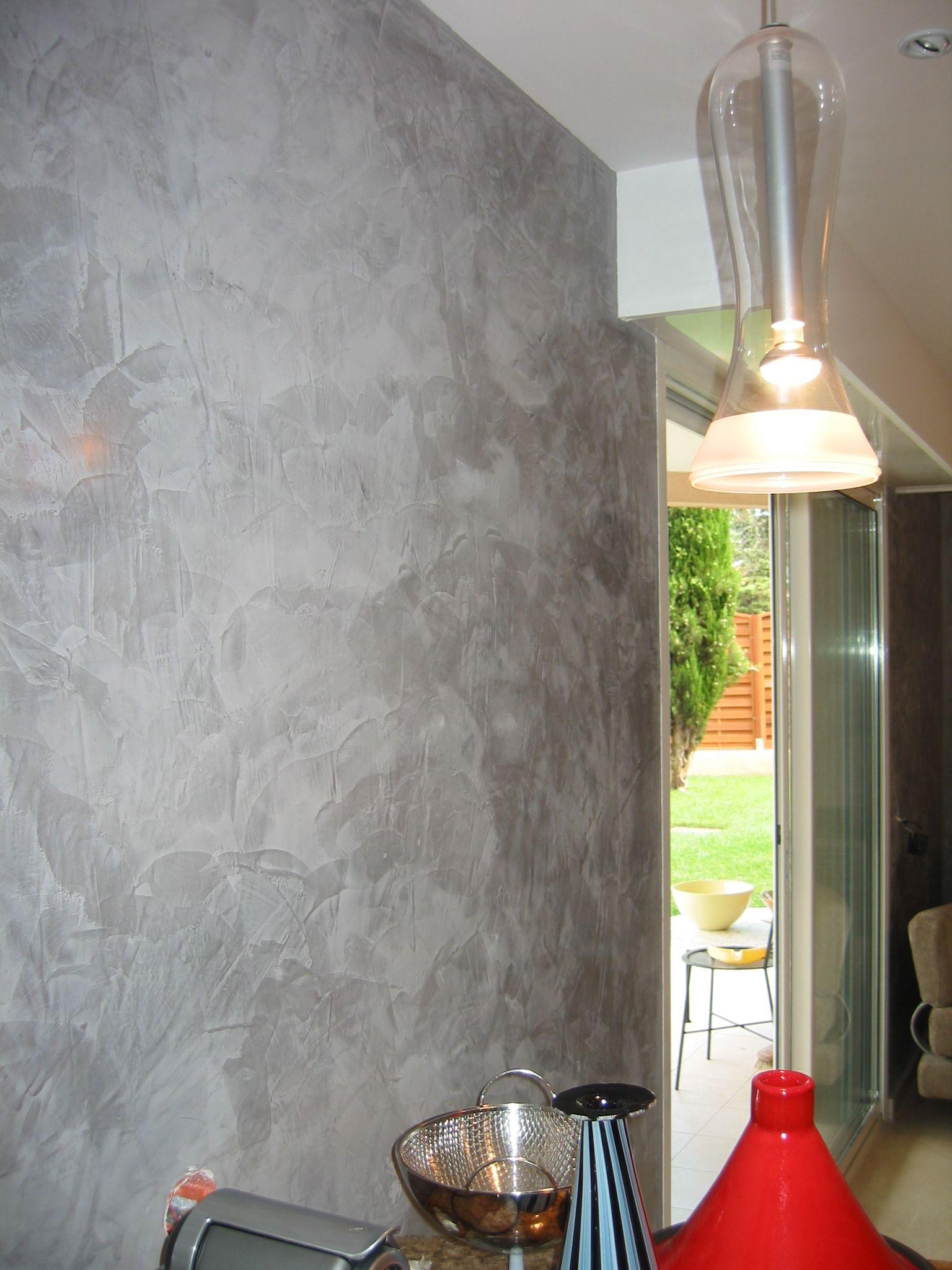 This stays - medium grey Venetian plaster on the far wall.