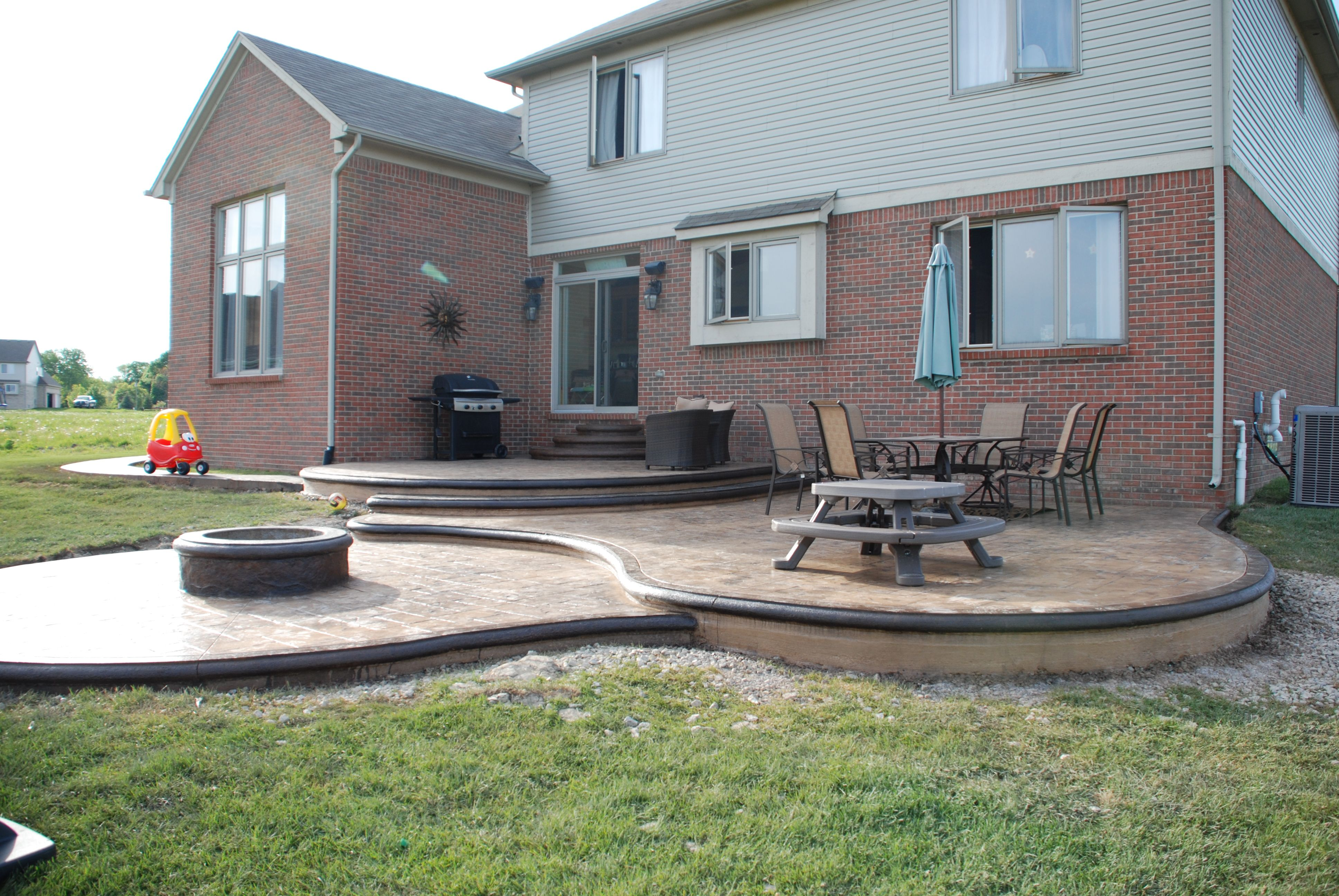 Custom Designed Stamped Concrete Patio Withbuilt-in Fire Pit
