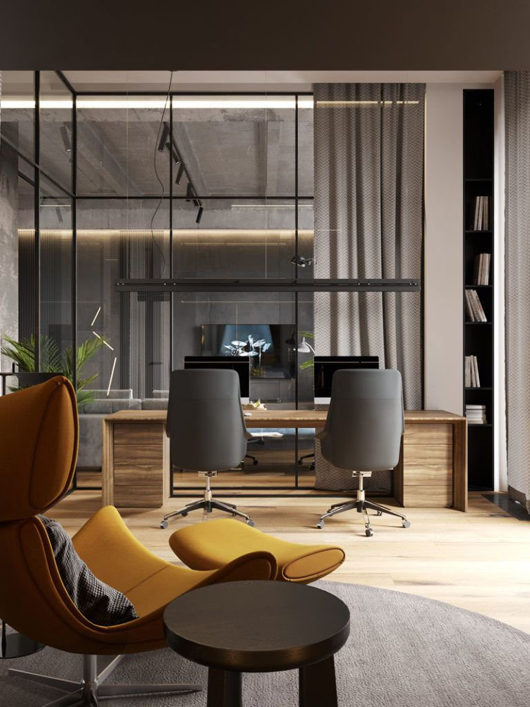 A Glass Wall Separates The Living Room From The Home Office In