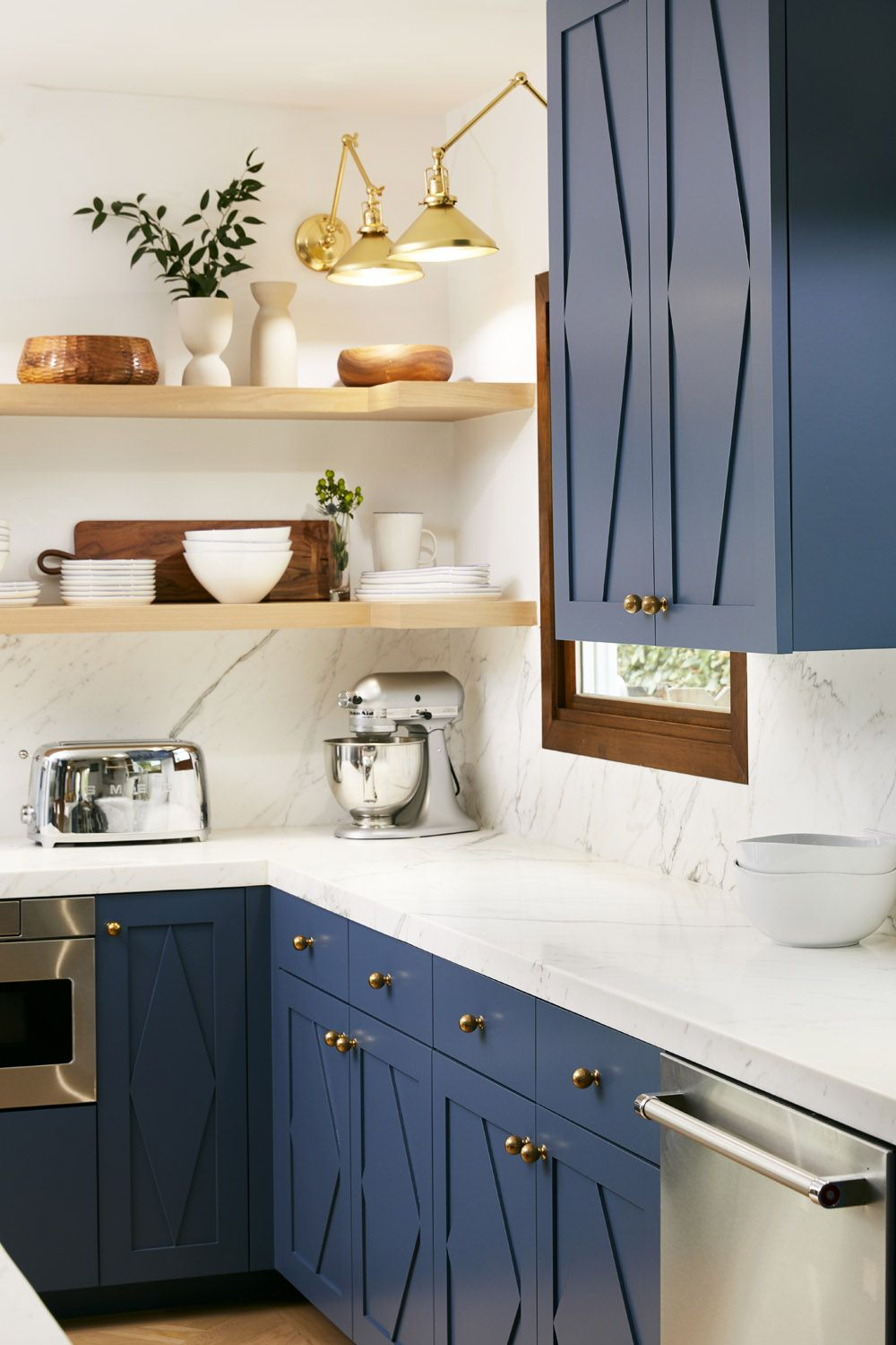 A Spanish Contemporary Bungalow In Venice Beach Rue Kitchen Cabinetry Kitchen Remodel Blue Kitchen Cabinets