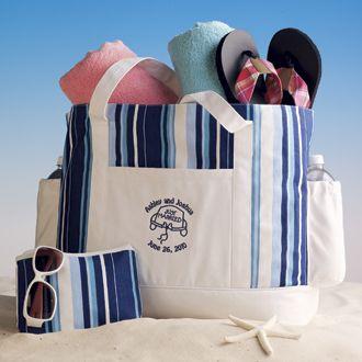 This honeymoon bag is beach-ready with nylon lining, a key clip ...