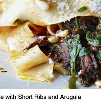 Short Ribs Pappardelle with Arugula @keyingredient #cheese #tomatoes #appetizer