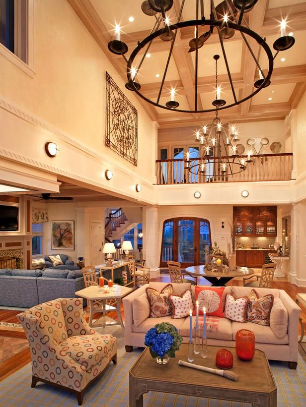 Stepping Into The Two Story Great Room Of That Same Nantucket Style Home Designer Bruce Palm High Ceiling Living Room Coastal Living Rooms Coastal Living Room