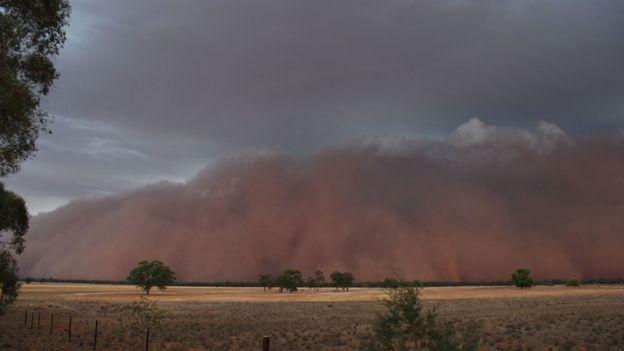 Australia fires Storms wreak damage but bushfires 'far
